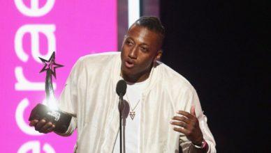 Lecrae receiving award