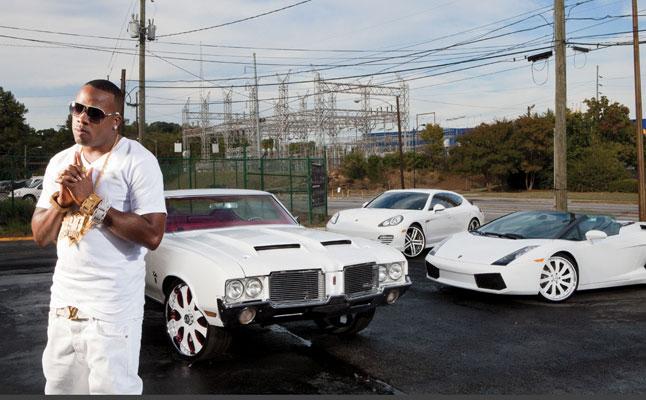 Yo Gotti with his cars