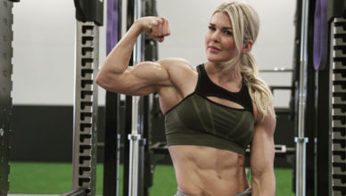Brooke Ence flexing her bicep