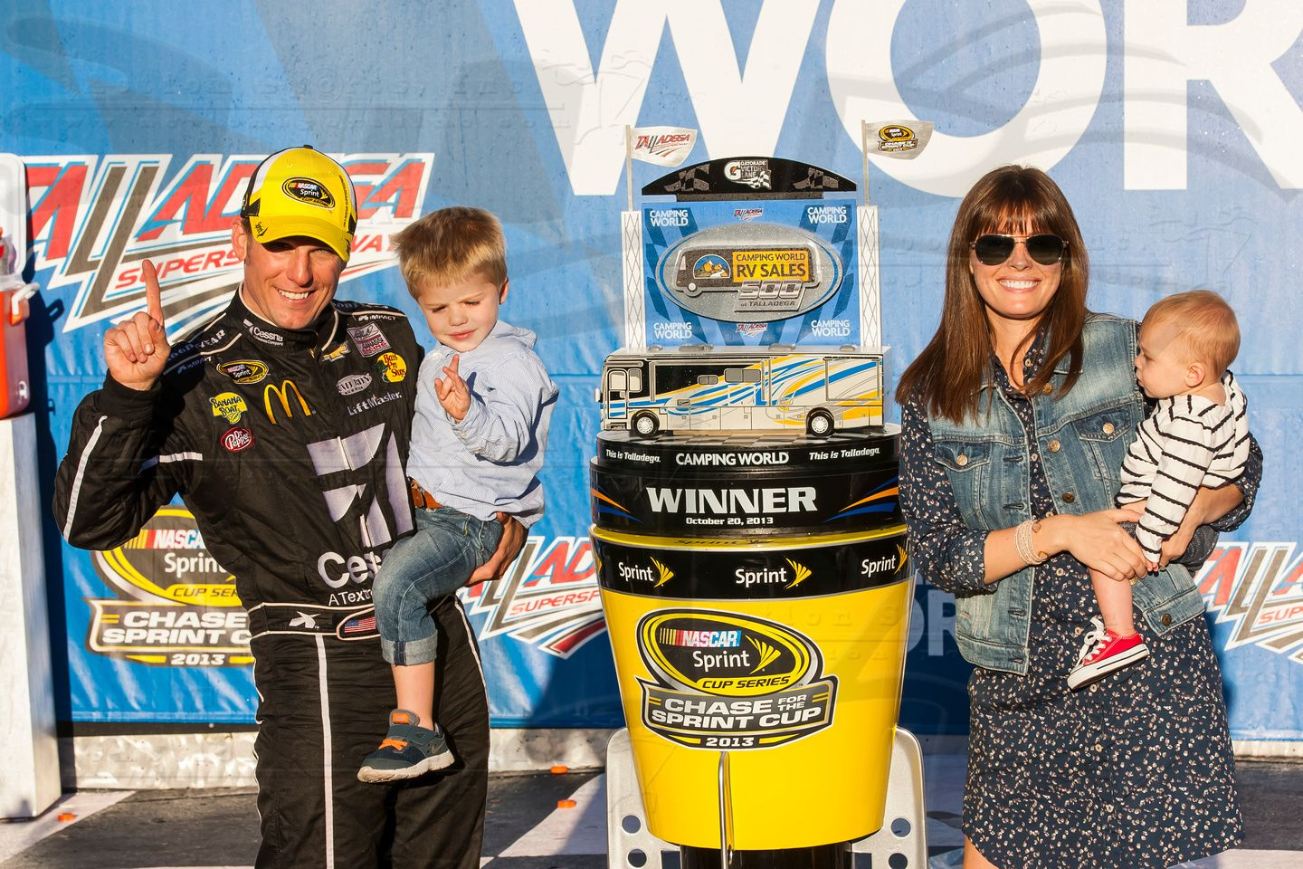 Jamie McMurray with his wife and children