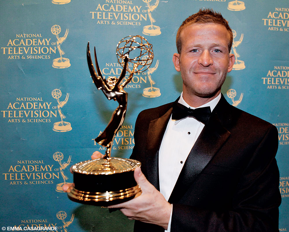 Andy posing with his Emmy