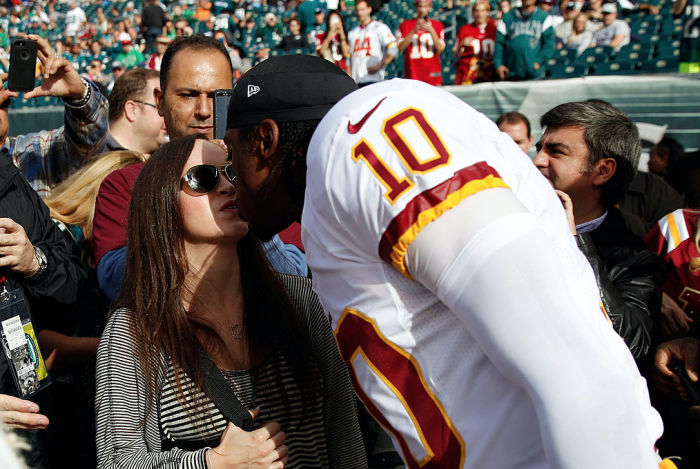 Rebecca Liddicoat and Robert Griffin III kissing each other