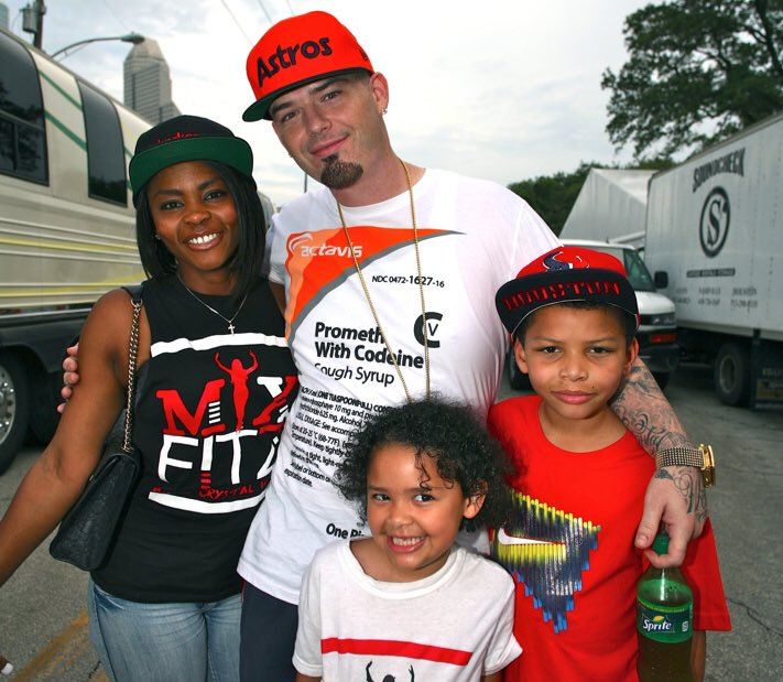 Paul Wall with his wife and children