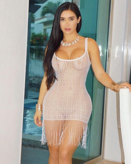 Joselyn Cano stands tall with a height of 5 ft inch